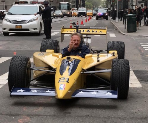 Larry Bird drives IndyCar through midtown Manhattan