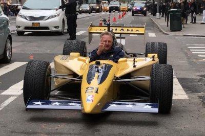 Larry Bird drives IndyCar through midtown Manhattan