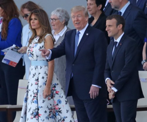 Melania Trump honors France with floral dress in Paris