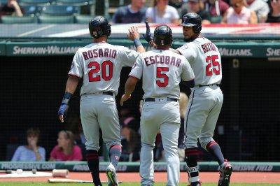 Late hits by Eduardo Escobar, Eddie Rosario guide Minnesota Twins past New York Yankees