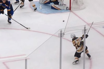 Boston Bruins' Brad Marchand buries rocket one-timer against Blues