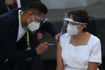 Mexico, Chile, Costa Rica begin administering COVID-19 vaccine