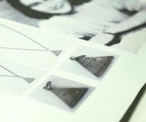Nazi death camp researchers unearth pendant with Anne Frank link