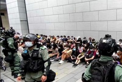 Hong Kong: Police arrest 180, fire pepper guns on protesters