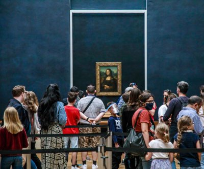 Louvre Museum reopens to limited visitors, new health rules