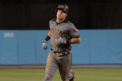 MLB: Jake Lamb's six RBIs help Arizona Diamondbacks rout Cincinnati Reds