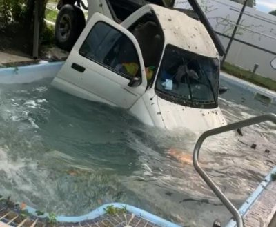 Pickup truck leaves Florida road, ends up in swimming pool