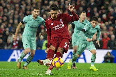 Liverpool guts Gunners behind Firmino's 2 goals in 90 seconds