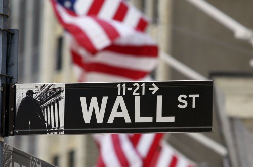 Fed gives stocks a late boost