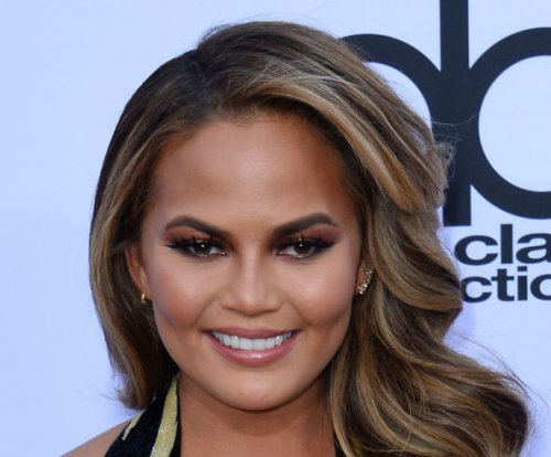 Chrissy Teigen addresses tripping, eye rolling incidents