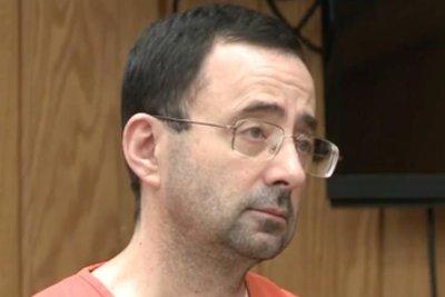 Feds seek 60-year sentence for ex-gymnastics doctor Larry Nassar