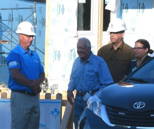 Jimmy Carter back at construction site after dehydration scare