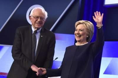 Clinton, Sanders vow to end mass deportations, split on other immigration reforms