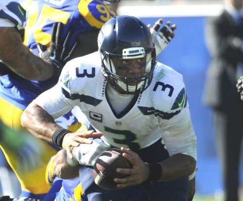 Seattle Seahawks' Russell Wilson plays through injury, excels against New York Jets