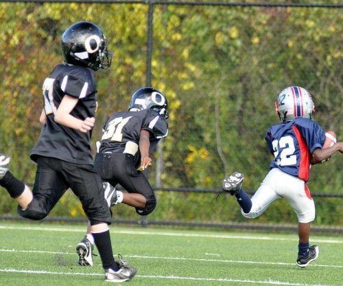 Force, frequency of hits to head increase as football-playing children age
