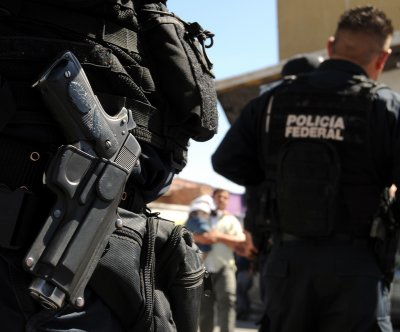 Mexican police officers charged with torturing women over executions