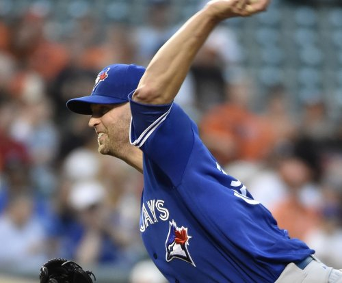 J.A. Happ wins 18th, Toronto Blue Jays inch closer to first