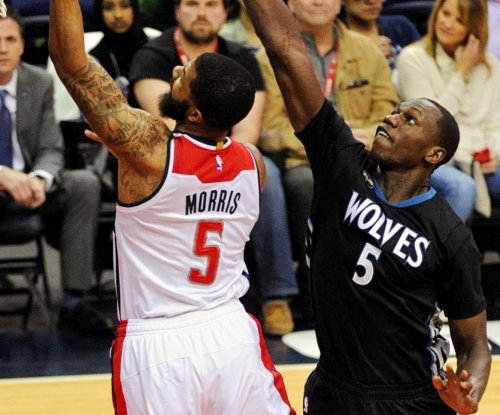 Minnesota Timberwolves rally past Washington Wizards in 2 OTs