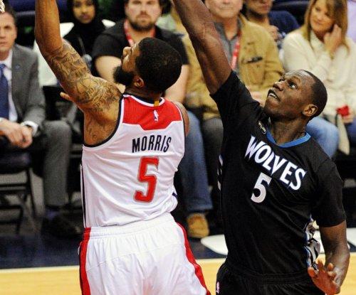 Minnesota Timberwolves rally past Washington Wizards in 2 OTs