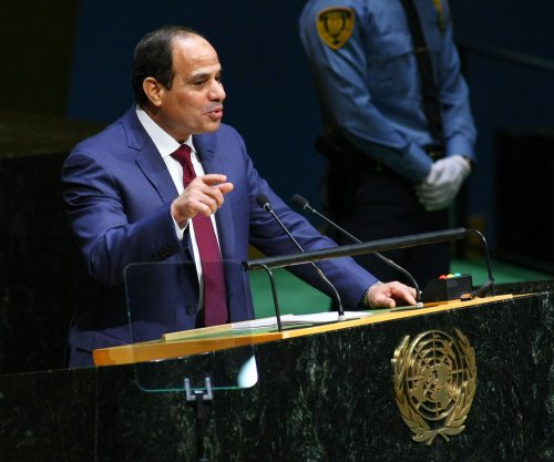 Merkel hosts Sisi amid human rights protests, slurs