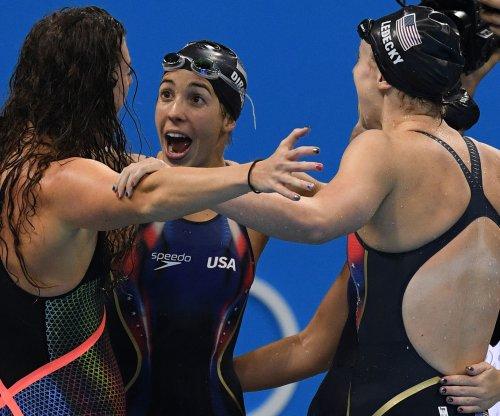 Rio Roundup: U.S. basketball beats Australia, Phelps edges Lochte