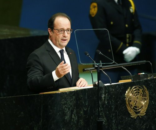 French President Francois Hollande calls for Calais 'Jungle' refugee camp closure