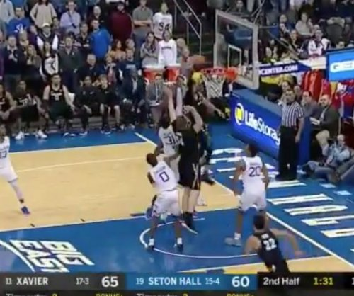Xavier's J.P. Macura jumps over Seton Hall for powerful dunk
