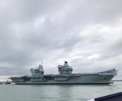 HMS Prince of Wales, Britain's newest aircraft carrier, arrives in port after trials