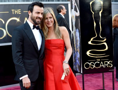 Aniston-Theroux wedding said to be on hold