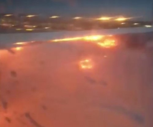 Singapore Airlines flight catches fire on emergency landing