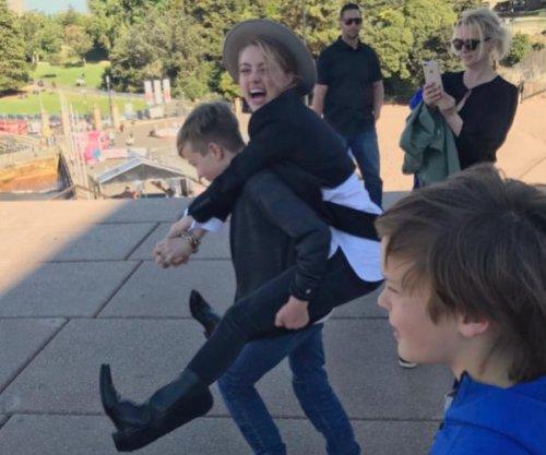 Amber Heard bonds with Elon Musk's kids in new photo