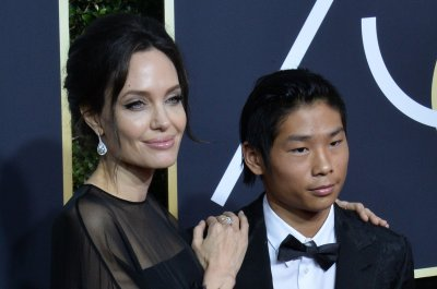 Angelina Jolie brings son Pax to 2018 Golden Globes