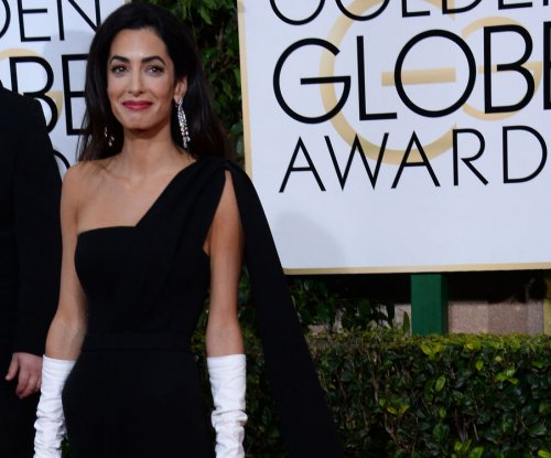 Amal Clooney shuts down fashion questions during Armenia Genocide case