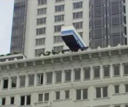 Bus sculpture teeters on hotel roof in 'Italian Job' nod