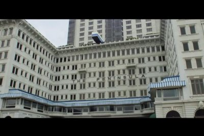 Bus sculpture teeters on hotel roof in 'Italian Job' nod