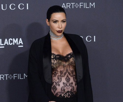Kim Kardashian wears bold, black-lace jumpsuit to LACMA gala