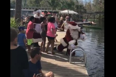 Santa Claus' island arrival takes a soggy turn in Florida
