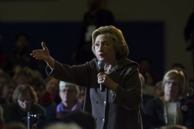 Clinton heckled about husband's sex scandals at NH town hall meeting