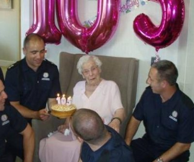 105-year-old woman gets birthday wish -- 'burly' firefighters