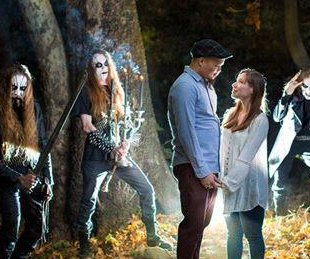 Couple taking engagement pics find metal band in the woods, ask them to join