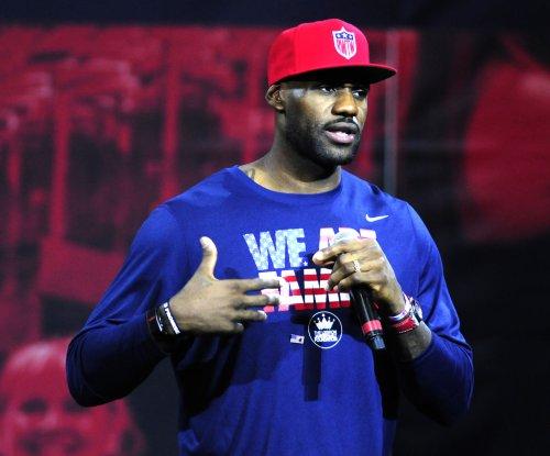 LeBron James still ailing; Cleveland Cavaliers cut four