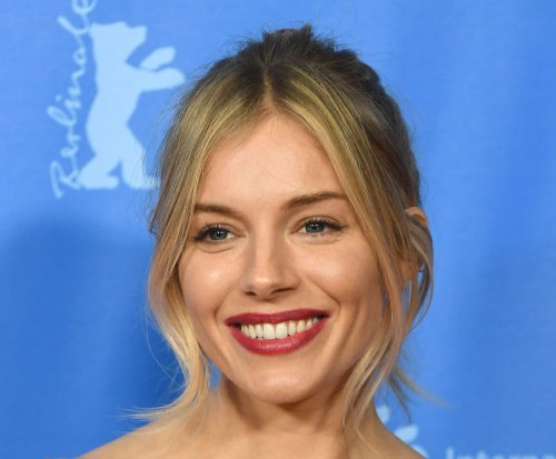 Sienna Miller says Brad Pitt dating rumors are 'silly'