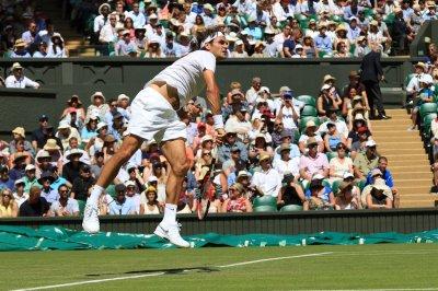 Federer, Murray, Nadal roll in Wimbledon openers