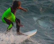 Australian 10-year-old photographed surfing over a great white shark