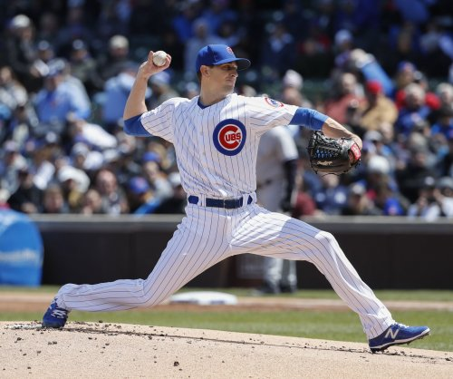 Kyle Hendricks helps Chicago Cubs hand Cincinnati Reds 5th straight loss