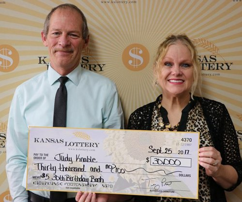 Kansas woman converts $15 lottery win into $30,000 jackpot