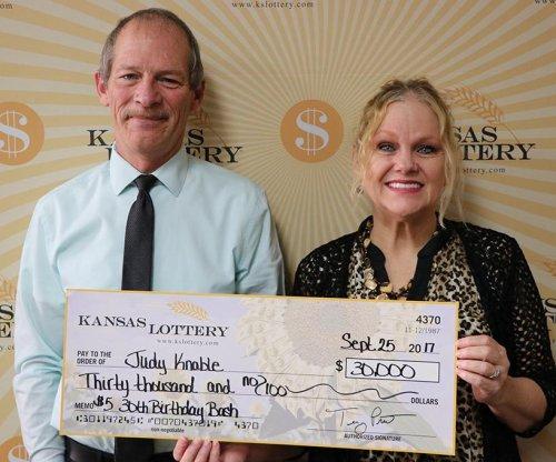 Kansas woman converts $15 lottery win into $30,000 jackpot