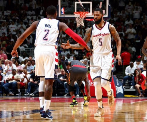 John Walls' 32 points lead Washington Wizards past Atlanta Hawks in Game 1