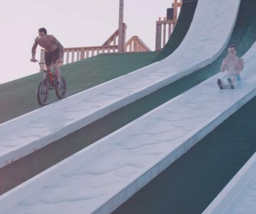Viral 'super slide' video features slow-motion back-flips, BMX tricks