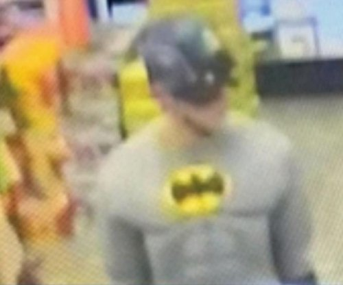 New York police seek mismatched superhero in beer theft